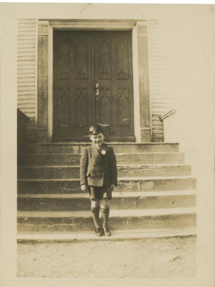 thumbnail_unknown kid and front of a church